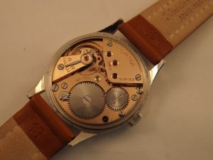 Omega, manual wind with off set second hand, movement